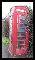 Forlorn Phone Box - Open for poem (Margaret Edge the bee girl) Tags: telephonebox red dirty ivy clinging outdoors windows old shireoaks nottinghamshire sad poem gpo leaning
