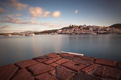 Sunday Morning (Eugenios X.) Tags: longexposure nx300 porosisland galatas seascape greece rocks boats sky sun clouds
