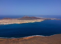 #lanzarote #sea #mountins #islands #blue #orange #colours #sand #sky #view (laurenbridge12) Tags: lanzarote sea mountins islands blue orange colours sand sky view