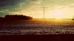 Infinite January (mobile pic) (Marcel Bakker) Tags: sun yellow yellowsky snow vintage power pylon meadow hdr beautiful