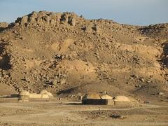 Chad Tibesti  Yebbi Bou (ursulazrich) Tags: tschad chad ciad tchad sahara desert tibesti huts houses village fuel barrel tankstelle