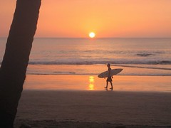 Sunset Surf (chrisheuer) Tags: sunset beach surfer tamarindo costarica2004 sunsetsurf eldiria