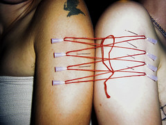 siamese twins (glowingstar) Tags: sanfrancisco thread pain bdsm needle pierce kink goodvibrations goodvibes piercingplay