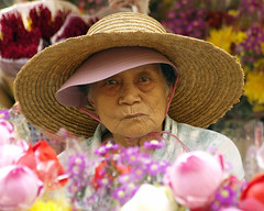 Flower Lady (espion) Tags: portrait people temple chinese theface singaporean 300v blogoffame xgf02 x0201 x0202
