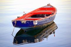Boat Reflection (RobW_) Tags: sunset reflection water 1025fav 510fav boat roadtrip 2006 greece macedonia 2550fav april thessaloniki apr2006 01apr2006 impressedbeauty ysplix