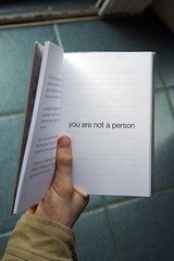 slim volume (Nad) Tags: person book thought hand you tiles page thumb cuff