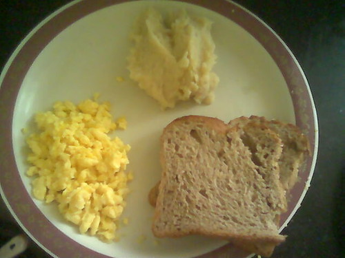 Mashed potatoes, Eggs, and Bread - breakfast at 5 PM by Premshree Pillai.
