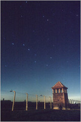 Auschwitz (Danny Fontaine) Tags: longexposure nightphotography light abstract art night dark stars religious lights weird moving scary abstractart nazi spooky mysterious ww2 nightshots nightsky auschwitz ai nightphotos birkenau concentrationcamp nightpics nightphotographs antidoteandinfamy dannyfontaine religiousphotography