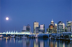 Moon Rise Over Vancouver City (Oliwilken) Tags: blue sunset moon reflection water vancouver buildings boats dawn moonrise bluehue vancouvercity oliwilken moonriseovervancouvercity nikonstunninggallery