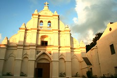Sto Domingo Cathedral (Farl) Tags: door travel white heritage church colors yellow stone architecture facade islands earthquake catholic shadows cross cathedral faith philippines religion north arches portal simbahan basco tradition portals reconstruction batanes stodomingo