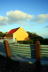 Abad (Farl) Tags: door travel blue house heritage colors yellow architecture night clouds bench islands peeling paint philippines curves north arches portal basco tradition portals abad batanes bluelist tukon butchabad