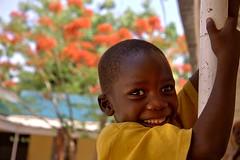 flamboyant (janchan) Tags: africa flowers red portrait people orange smile kids children happy nigeria flamboyant forward kano fulani hausa blackribbonicon whitetaraproductions sfidephotoamatori
