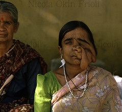 Indian-Untouchable (Nicola Okin Frioli) Tags: portrait india person photography photo foto sad bangalore photojournalism 1999 oldwoman putaparti photojournalist photograpy portrature untouchable okin sadwoman okinreport wwwokinreportnet nicolaokinfrioli sadeye nicolafrioli