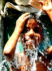 How to beat the Indian Summer  = Step 3 (lecercle) Tags: life summer india hot kids children heat mumbai coolingdown scoopt dharavi bluelist mecurcy