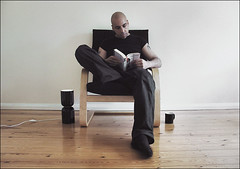 . Tea With Murakami . (3amfromkyoto) Tags: wood light portrait selfportrait man male me cup lamp self reading book wooden chair sitting floor tea drinking norwegian sp mug murakami cha haruki harukimurakami pgtips norwegianwood milkonesugar 3amfromkyoto flickr:user=3amfromkyoto