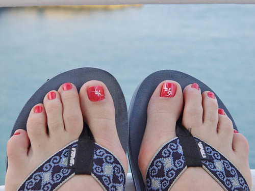 Good painted toenails and flip flops apologise