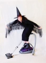a modern day witch (Janet Leadbeater) Tags: motion black blur hat topv111 modern flying topv333 purple witch magic vacuum witchs batwings purge topvaa