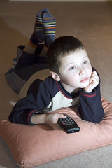 AFS-060008.jpg (Alex Segre) Tags: uk family boy england people male home television children person tv europe alone child britain expression young relaxing bored lifestyle leisure remotecontrol activity modelrelease alexsegre