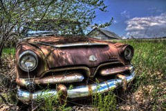 Rusty Dodge (Lawrence Whittemore) Tags: trees sky car clouds trash junk automobile wind rusty dodge hdr lawrencew