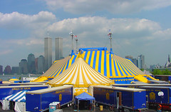Dralion's Big top with the Twin Towers (Pat Rioux) Tags: blue newyork yellow skyline site jerseycity circus manhattan worldtradecenter tent infrastructure twintowers wtc masts cirque cirquedusoleil bigtop dralion grandchapiteau