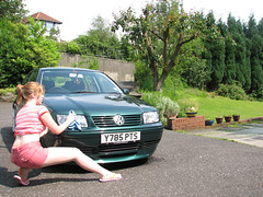 Washing the car (RainAtDawn) Tags: pink portrait woman green me wet girl vw female self golf interestingness scottish wash sp 110fav bora volkwagen soapy interestingness13 bolf i500