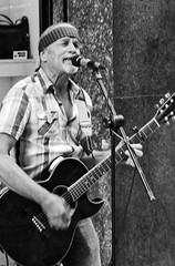 Street music. (vieira.de.carvalho) Tags: street streetartist musician oldhippie bw saopaulo nikomat ft2 nikkor50mm manualfocus d76h plustek 8200i