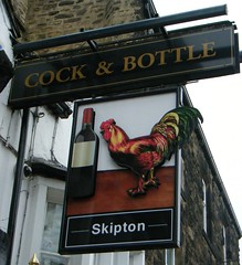 Skipton, West Yorkshire- Cock and Bottle Public House (rossendale2016) Tags: fashioned old creaking rusty oiled hinges swinging pavement paved street premises onoroff drinking licence off spirits wines beers local hen wine lifelike neat original handpainted hand dales yorkshire riding opening time closing bar clever unique picturesque photogenic busy brewery beer countryside urban centre town road main mainroad replica painted outside board skipton west bottle house cock public