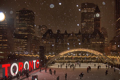 Nathan Philliips Square on a Snowy Night (A Great Capture) Tags: agreatcapture agc wwwagreatcapturecom adjm ash2276 ashleylduffus ald mobilejay jamesmitchell toronto on ontario canada canadian photographer northamerica torontoexplore torontoexplorewinter l'hiver 2016 nathanphillipssquare cityhall ice rink skating skate snow snowy night shot nighttime dark lights old arches share3dto 3d sign iconic red white snowing evening frozen shadows colours colors ig