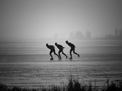 This is Holland (ParadoX_Design) Tags: blackandwhite s ice skating frozen winter sport entertainment people men cold holland netherlands typical fun leisure horizon lake eemmeer eemnes huizen netherland gooi dutch