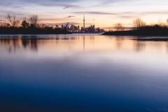 A Still Moment (Smaku) Tags: sunrise lakeontario landscape ontario toronto water longexposure cntower orange blue red yellow nature urban cityscape