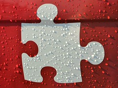 Metal Jigsaw Puzzle Piece and Raindrops (@CyprusPictures) Tags: stockphoto stockimage getty white redbackground red raindrops metal metallic jigsawpiece puzzlepiece puzzle shape