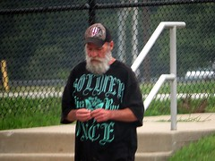 I bet the old timer had his IU cap for a long time. (kennethkonica) Tags: old city people urban men america canon fence beard women midwest sitting outdoor candid indianapolis seat indy indiana tshirt beggar mature cap sit facialhair iu seated economy begging panhandler beg canonpowershot marioncounty