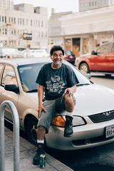 Man and His Mickey's (neocastillo) Tags: street people urban man car zeiss downtown sitting drink candid sony 8 f1 55mm 18 a7 mickeys a7ii