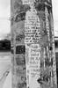 Torn Words (Georgie_grrl) Tags: 7thanniversarywalk torontophotowalks social photographers friends toronto ontario topwa7 pentaxk1000 rikenon12828mm blackandwhite monochrome torn poster ripped words