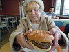 """Mom turned 88 years old, but can still handle a Burger King """"Double Bacon King"""" sandwich!  2 large quarter-pound beef patties with cheese between them and a big load of bacon on the top.  Here, she studies the optimum approach to this monster. Dec 2016 (wavz13) Tags: parents mother mothers agingparents healthyeating family familyphotos familyphotography moms agingmoms hamburgers fastfood restaurants cheeseandbacon largehamburgers largeburgers hugeburgers fastfoodrestaurants baconandcheese hugehamburgers women woman eating dining lunch lunchtime elderly elderlywomen olderwomen fastfoodburgers fastfoodhamburgers agingmothers healthfood meltedcheese juicyburgers juicyhamburgers cheeseburgers gianthamburgers giantburgers bigburgers bighamburgers"""