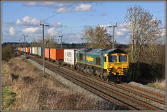 66534, Murcott (Jason 87030) Tags: freight frame border murcott northants longbuckby northamptonshire line loop wcml gm shed class66 66534 liner 4l90 ts lineside field sky clouds march 2009 ditton felixstowe cargo containers frecht boxes weather canon locomotive railways uk