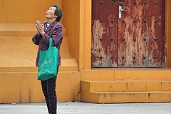 Qibao Temple (Robert Borden) Tags: yellow red world china asia shanghai qibao temple woman prayer travel canon portrait street purple green bag