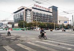 Bikes on Wangfujing, Beijing, intersection (Victor Wong (sfe-co2)) Tags: architecture background beijing buildings business busy cars china city cityscape dongsiwest downtown fast freeway highway highwaytraffic interchange intersection junction landscape meishuguaneast network outdoors property road skyline skyscraper speed street traffic transport transportation travel urban view wangfujing way bikes motorbikes motorcycles cycles people cyclist bicycles