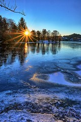 A cold morning, Norway (Vest der ute) Tags: xt2 norway rogaland haugesund earlymorning eivindsvatnet ice water waterscape winter trees sunrise sunstar bluesky blueazul snow reflections fav25 fav200