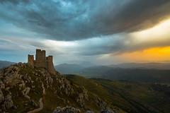 Between earth and sky (luigig75) Tags: calascio montagne rocca abruzzo italia mountains italy clouds nuvole sunset tramonto castle castello gransasso campoimperatore parconazionaledelgransassoedeimontidellalaga