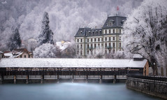 Frosty Town (VandenBerge Photography) Tags: frost hoarfrost thebeautyofnature thun aare river berneseoberland switzerland europe water winterscape winter season cityscape town trees floodgates historical canon le longexposure picturesque mountain