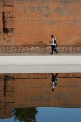 still (diminoc) Tags: morocco marrakech palaiselbadii architecture reflection pair wall orange water pool pond serene