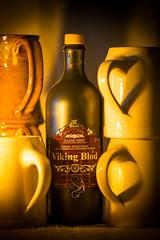 Viking Blod (Fret Spider) Tags: shadow blur art zeiss ceramic fire bottle candle general wine bokeh cork sony outoffocus flame hibiscus honey alcohol maritime mug nordic hop mead pint viking stein ef scandinavian ze liter earthenware 135mm oof seafaring sonnar blod a7ii mirrorless zeiss135mmf2 bokehdelicious aposonnart2135 sonnar1352ze sonnarapo1352ze danskmjod