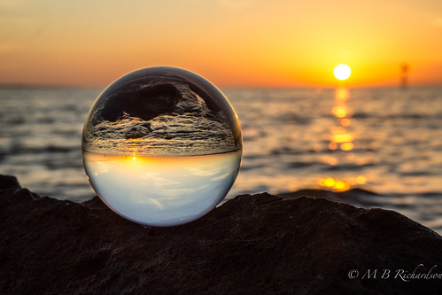 Crystal ball on rocks.