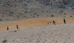 . (me*voilà) Tags: namibia landscape himba children running play herding goats