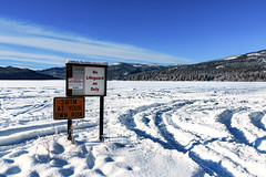 Swim at your own risk (Mark Pouley) Tags: colvillereservation inchelium logcabin northtwin rainbowbeach resort southtwin twinlakes washington frozen ice lake lakes landscape nature outdoors snowswim trees