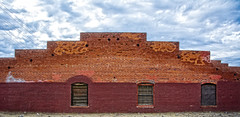 TRACKSIDE (akahawkeyefan) Tags: building painted brick windows fresno sky davemeyer