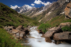 Summer Daydreaming (blum99) Tags: italy val ferret montblanc rifugio bonatti frassatti alps mountains hiking trekking tourdusaintbernard tsb stream river le longexposure blackglass summer flowers alpine courmayeur snow tourdumontblanc tmb canon canonef24105mmf4lisusm canon6d neutraldensity 10stop