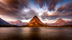 Wildfire Sunrise with motion (PIERRE LECLERC PHOTO) Tags: glaciernationalpark mountgrinnell mountain rockies montana rockymountains sunrise swiftcurrentlake lake water shore nature landscape dramaticsky dramatic moody manyglacier usa america adventure wilderness roadtrip zen solitude peak smoke wildfire clouds sunriseglow longexposure wildfiresunrise travel populardestination sceniclocations autumn fall naturalbeauty pierreleclercphotography canon5dsr plotagraph cinemagraph movingphoto motion animatedphotos animation animated hdvideo video