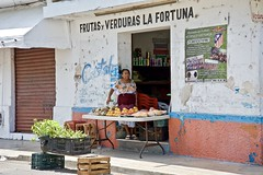 Frutas y Verduras La Fortuna (Rob Sneed) Tags: mexico progresso shop produce sign fruitsandvegetables shopkeeper commerce retail signs advertising street vendor cristal crates table urban poster futbol